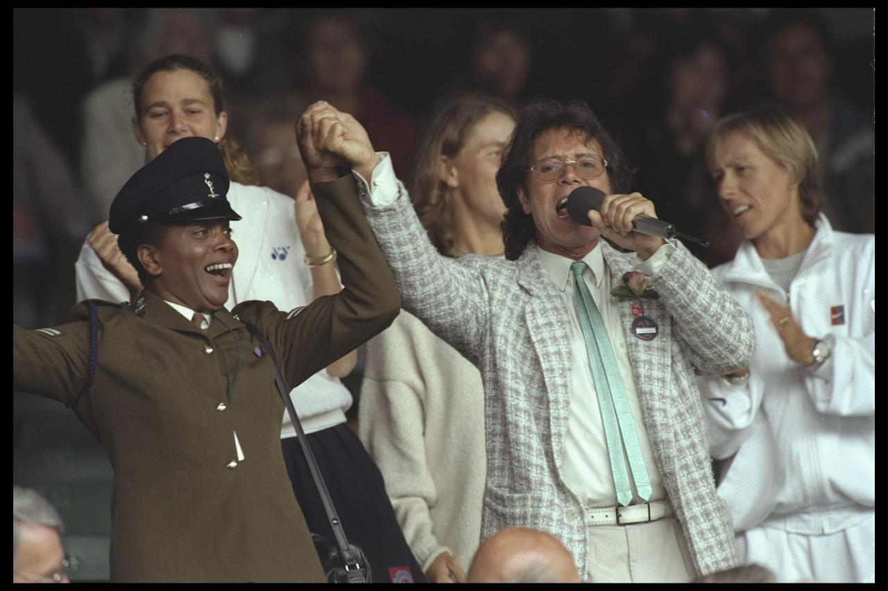 """<p class=""""MsoNormal""""><span>In <b>1996,</b> during a rainy afternoon on Centre Court, your Auntie's favourite British crooner Sir Cliff Richard (think Michael Bublé in 30 years), a frequent Wimbledon attendee, helped pass the time with an impromptu sing-along, including """"Singing in the Rain."""" While the teenagers cringed, the adults managed to forget their sodden wool jumpers for half an hour or so.</span></p>"""