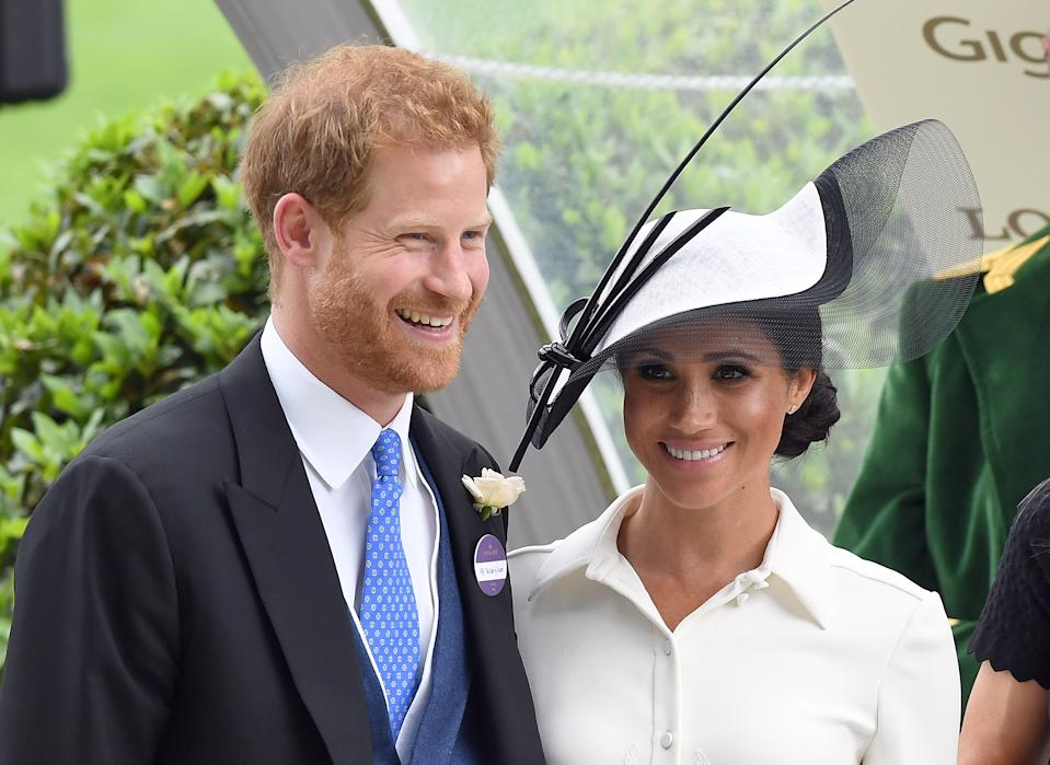 ASCOT,  UNITED KINGDOM - JUNE 19:  Prince Harry, Duke of Sussex and Meghan, Duchess of Sussex, making her Royal Ascot debut, attends day one of Royal Ascot at Ascot Racecourse on June 19, 2018 in Ascot, England. (Photo by Anwar Hussein/WireImage)