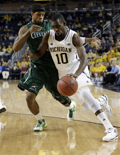 Michigan guard Tim Hardaway Jr. (10) drives on Cleveland State guard Sebastian Douglas (1) during the first half of their NCAA college basketball game in the second-round of the NIT Season Tip-Off tournament at Crisler Arena, Tuesday, Nov. 13, 2012, in Ann Arbor, Mich. (AP Photo/Paul Sancya)