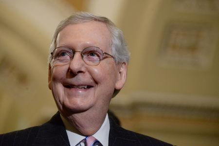 FILE PHOTO: Senate Majority Leader Mitch McConnell speaks with reporters following a policy luncheon in Washington, U.S. March 12, 2019. REUTERS/Erin Scott/File Photo