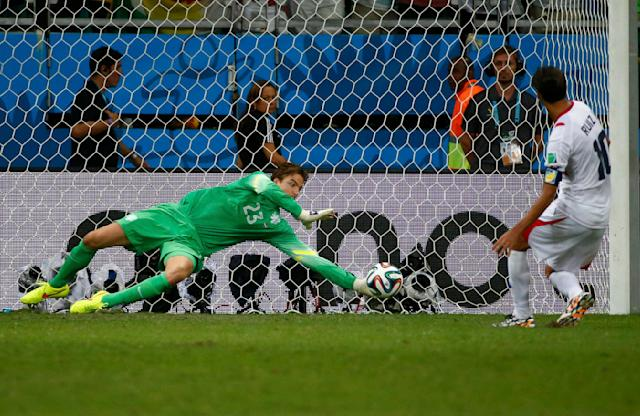 Goalkeeper Tim Krul of the Netherlands saves a shot by Costa Rica's Bryan Ruiz during a penalty shootout in their 2014 World Cup quarter-finals at the Fonte Nova arena in Salvador July 5, 2014. REUTERS/Michael Dalder (BRAZIL - Tags: SOCCER SPORT WORLD CUP TPX IMAGES OF THE DAY)