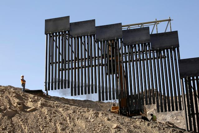 A construction crew works on a private border wall in May at Sunland Park, N.M., as pictured from Ciudad Juárez, Mexico. (Photo: Jose Luis Gonzalez/Reuters)