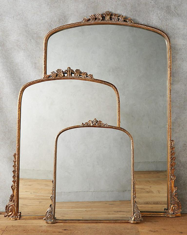 """<p>Hang a mirror over the mantel to bounce light around the room and create the illusion of space. Go for an ornate gold mirror for a luxurious feel, or for a more minimal look try a modern round mirror.</p><p><em>Anthropologie """"Gleaming Primrose"""" Mirror, from $448, <a href=""""https://click.linksynergy.com/deeplink?id=93xLBvPhAeE&amp;mid=39789&amp;u1=MMSLHOMEFireplaceDecorESwansAug19&amp;murl=https%3A%2F%2Fwww.anthropologie.com%2Fshop%2Fgleaming-primrose-mirror2%3Fcolor%3D020%26quantity%3D1%26type%3DSTANDARD"""">anthropologie.com</a>.</em></p>"""