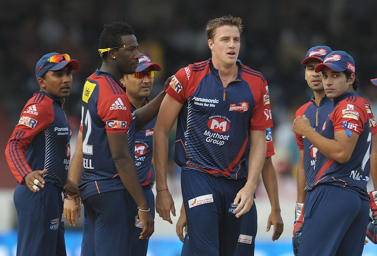 Delhi Daredevils bowler Morne Morkel (C) celebrates taking the wicket of Deccan Chargers batsman  Daniel Harris (unseen) with teammates during the IPL Twenty20 cricket match between the  Deccan Chargers and Delhi Daredevils at Rajiv Gandhi International Stadium in Hyderabad on May 10, 2012. RESTRICTED TO EDITORIAL USE. MOBILE USE WITHIN NEWS PACKAGE.  AFP PHOTO / Noah SEELAM        (Photo credit should read NOAH SEELAM/AFP/GettyImages)