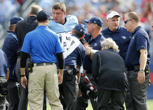 Tennessee Titans tackle David Stewart is helped onto a cart after breaking his right leg in the first quarter of an NFL football game against the Houston Texans, Sunday, Dec. 2, 2012, in Nashville, Tenn. (AP Photo/Joe Howell)