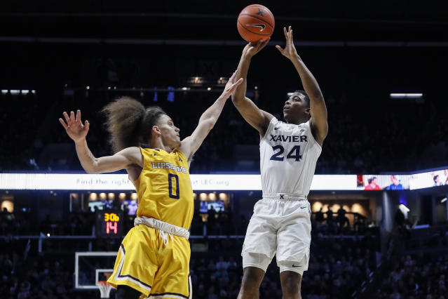 Xavier's KyKy Tandy (24) shoots over Lipscomb's KJ Johnson (0) during the first half of an NCAA college basketball game, Saturday, Nov. 30, 2019, in Cincinnati. (AP Photo/John Minchillo)