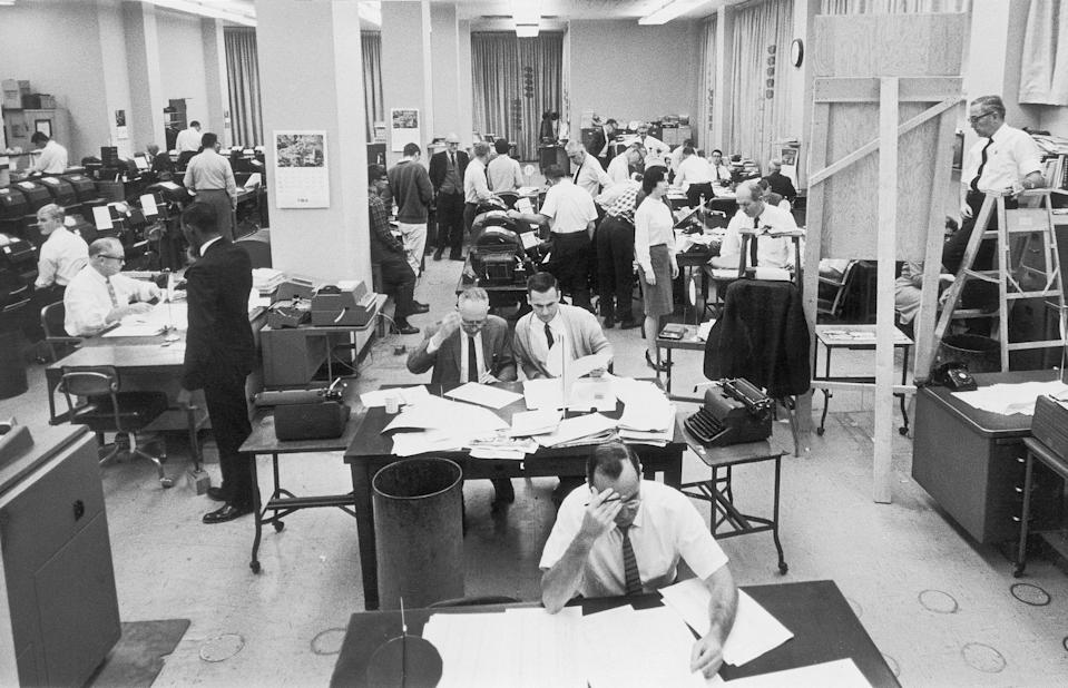 Staffers work on election night at the Washington, D.C. bureau of The Associated Press on Nov. 3, 1964. (AP Photo/File)