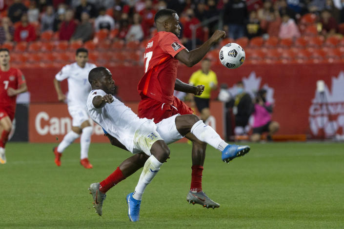 Honduras' Maynor Figueroa, left, stops a drive by Canada's Cyle Larin into the box during the second half of a World Cup soccer qualifying match in Toronto on Thursday, Sept. 2, 2021. (Chris Young/The Canadian Press via AP)