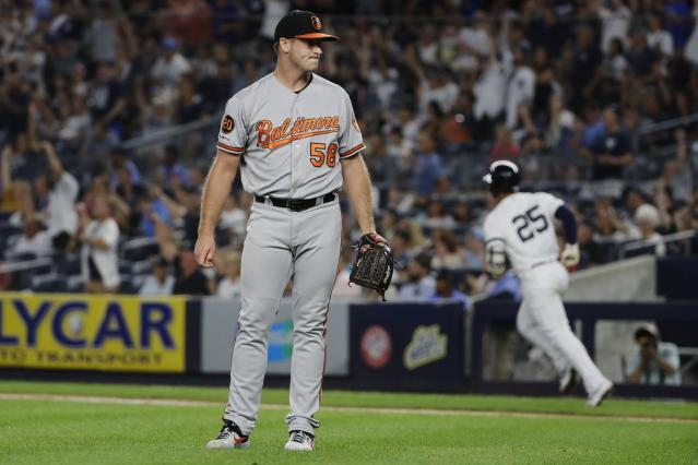 Baltimore Orioles' Evan Phillips (58) reacts as New York Yankees' Gleyber Torres (25) runs the bases after hitting a three-run home run during the fifth inning of the second game of a baseball doubleheader Monday, Aug. 12, 2019, in New York. (AP Photo/Frank Franklin II)