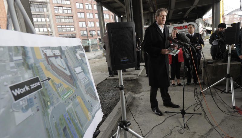 David Sowers, deputy administrator for the Alaskan Way Viaduct Replacement Program, speaks during a news conference Wednesday, Jan. 9, 2019, under the Alaskan Way Viaduct elevated roadway in Seattle. The double-decker viaduct, a major thoroughfare for commuters along downtown Seattle's waterfront, is set to shut down for good, Friday, Jan. 11, 2019, before it is replaced by a four-lane tunnel, ushering in what officials say will be one of the most painful traffic periods in the history of the city. (AP Photo/Ted S. Warren)