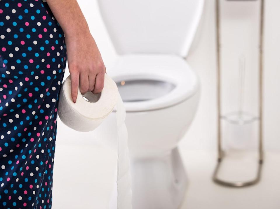 Close-up of woman on toilet in morning