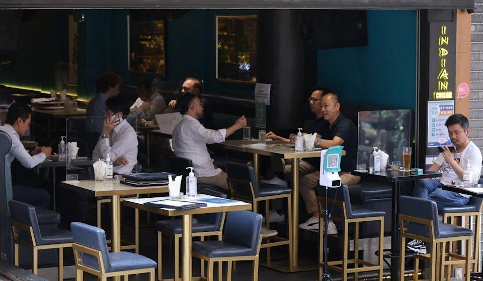 Bars and pubs are permitted to host four people per table. Photo: May Tse
