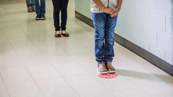PHOTO: Students standing in a socially distanced line in a school hallway. (Getty Images, FILE)