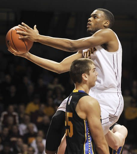 Minnesota's Andre Hollins goes to the basket past South Dakota State's Chad White during the second half of an NCAA college basketball game, Tuesday, Dec. 4, 2012, in Minneapolis. Hollins finished with a game-high 22 points. Minnesota won 88-64.(AP Photo/Tom Olmscheid)