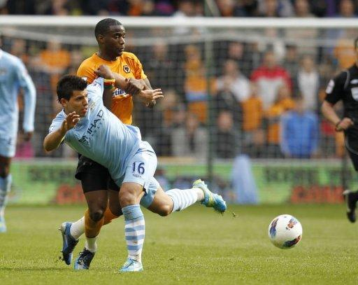 Manchester City's Sergio Aguero (L) vies with Wolverhampton Wanderers' Sebastien Bassong
