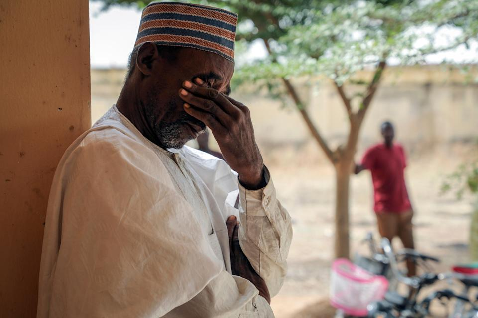 <p>Father Aliyu Ladan Jangebe, whose four daughters are among more than 300 girls who were abducted by gunmen on Friday from the Government Girls Junior Secondary School, waits for news</p> (Copyright 2021 The Associated Press. All rights reserved.)
