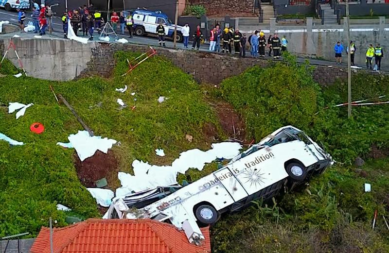 The bus plunged down a 10-metre slope with around 50 people on board (AFP Photo/STRINGER)