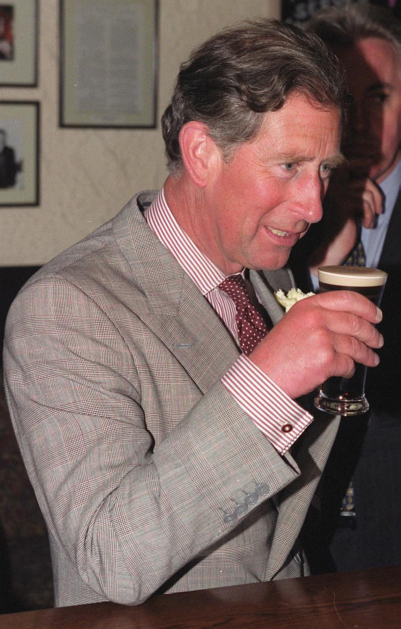 The Prince of Wales enjoys a half pint of Guinness in The Thatch Inn, Broughshane, during his visit to the village, near Ballymena in Northern Ireland. The Prince has spent the day meeting meet victims and relatives of those who died in the 1998 Omagh bomb atrocity. (Photo by Brian Little - PA Images/PA Images via Getty Images)