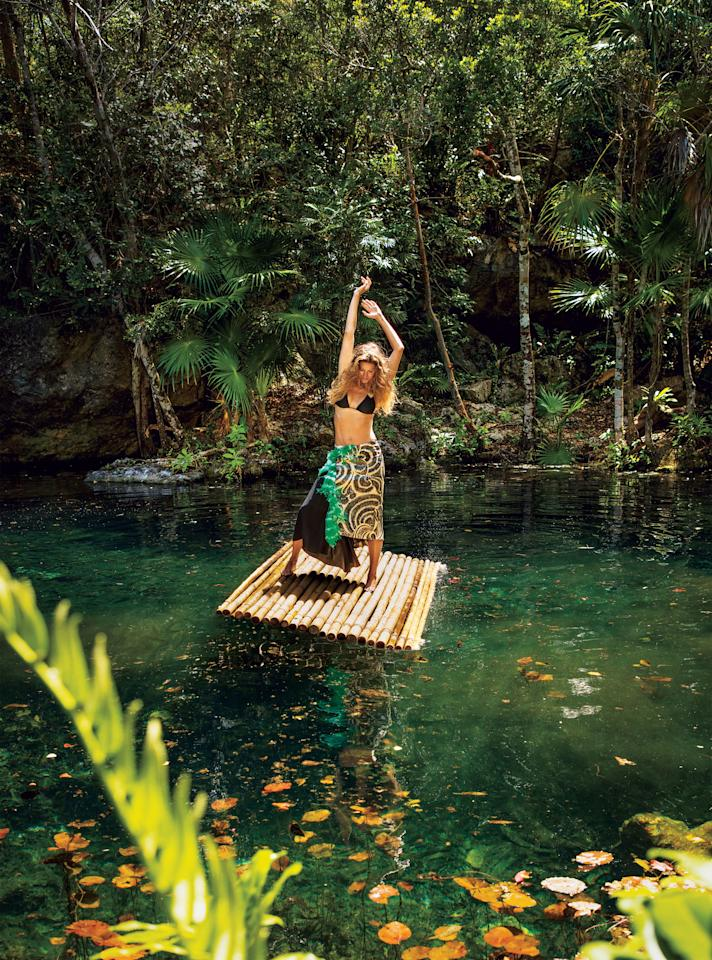 Gisele and her family escape to Costa Rica—where she is able to relax and live life barefoot and bikini-clad. La Perla bikini top. Dries Van Noten skirt.