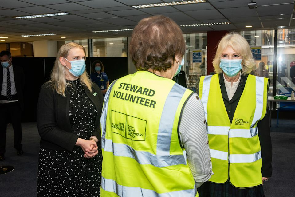 LONDON, ENGLAND - FEBRUARY 23: Camilla, Duchess of Cornwall, Royal Voluntary Service President, speaks to Louise Jacobs, a NHS Volunteer Responder Steward at Wembley Vaccination Centre on February 23, 2021 in London, England. (Photo by Philip Hartley-WPA Pool/Getty Images)