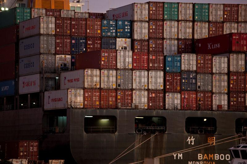 FILE PHOTO: The YM Bamboo, a container ship operated by the China Ocean Shipping Company (COSCO) is docked at the Port of Oakland in Oakland, California
