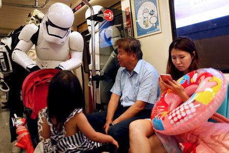 """A fan dressed as a Storm Trooper from """"Star Wars"""" reacts at the Taipei Metro (MRT) during Star Wars Day in Taipei, Taiwan May 4, 2017. REUTERS/Tyrone Siu"""