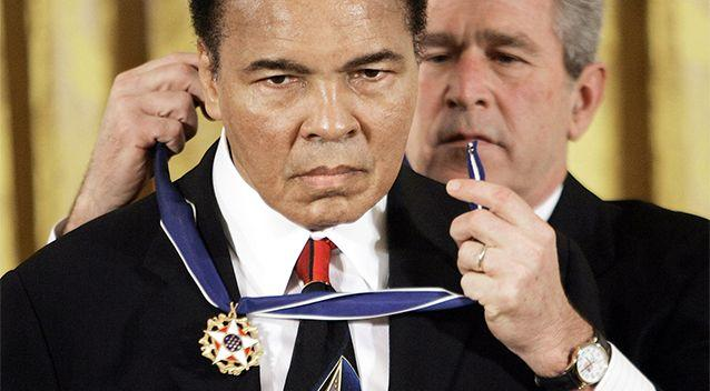 President George W Bush presents the Presidential Medal of Freedom to boxer Muhammad Ali in 2005. Photo: AP