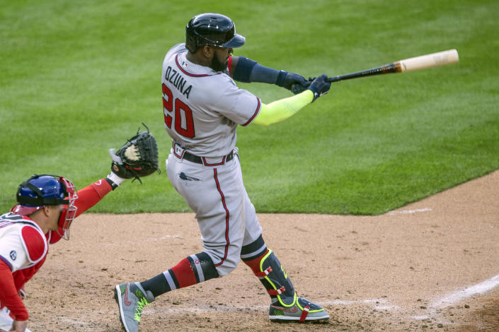 Atlanta Braves' Marcell Ozuna (20) swings for a strike during the seventh inning of a baseball game against the Philadelphia Phillies, Saturday, April 3, 2021, in Philadelphia. The All-Star Game patch that appeared on the right sleeve of the Braves' jerseys during opening day was sewn over Saturday against Philadelphia at Citizens Bank Park. (AP Photo/Laurence Kesterson)