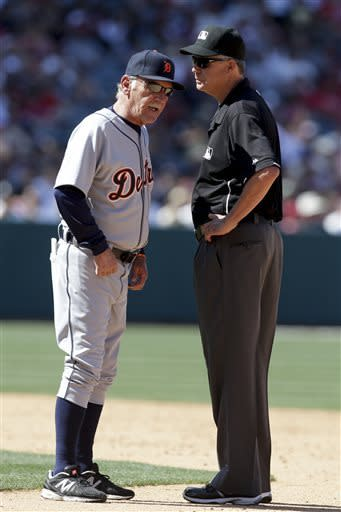 Detroit Tigers manager Jim Leyland, left, argues with second base umpire Gary Darling after Omar Infante was called out stealing second against the Los Angeles Angels during the ninth inning of a baseball game in Anaheim, Calif., Sunday, April 21, 2013. (AP Photo/Chris Carlson)
