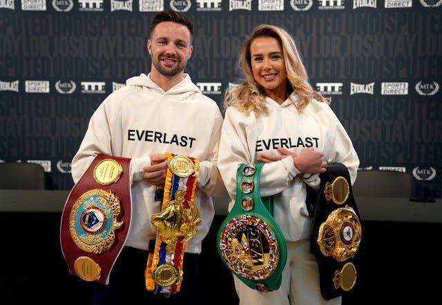 Boxer Josh Taylor, who is undisputed light-welterweight champion, shows off his belts at the new Sports Direct flagship store on Oxford Street, London, alongside his partner Danielle Murphy