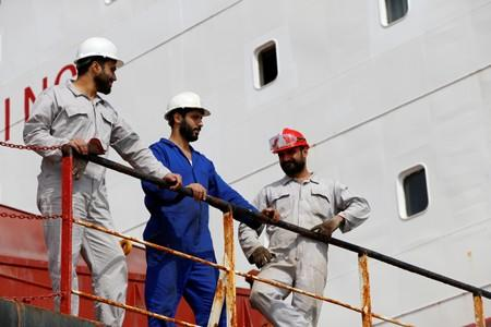 Members of the crew of the Iranian vessel Bavand are seen near the port of Paranagua