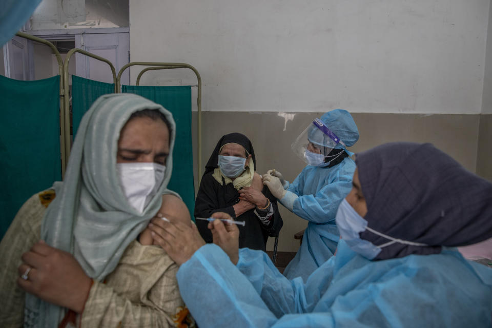 Kashmiri women receive COVISHIELD vaccine for COVID-19 at a primary health center in Srinagar, Indian controlled Kashmir, Wednesday, April 28, 2021. India, a country of nearly 1.4 billion people, Wednesday became the fourth nation to cross 200,000 deaths. (AP Photo/ Dar Yasin)