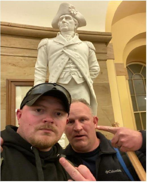The Justice Department released a photo of Jacob Fracker and Thomas Robertson, two off-duty police officers with the city of Rocky Mount, Va., inside the U.S. Capitol during the deadly riot Jan. 6.