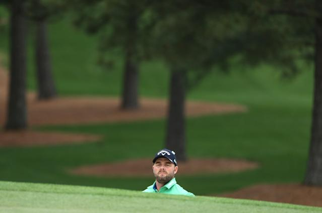 Marc Leishman of Australia looks out from a sand trap on the 7th hole during third round play of the 2018 Masters golf tournament at the Augusta National Golf Club in Augusta, Georgia, U.S. April 7, 2018. REUTERS/Lucy Nicholson