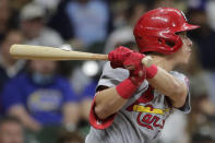 St. Louis Cardinals' Tommy Edman watches his RBI-single during the eighth inning of a baseball game against the Milwaukee Brewers Tuesday, Sept. 21, 2021, in Milwaukee. (AP Photo/Aaron Gash)