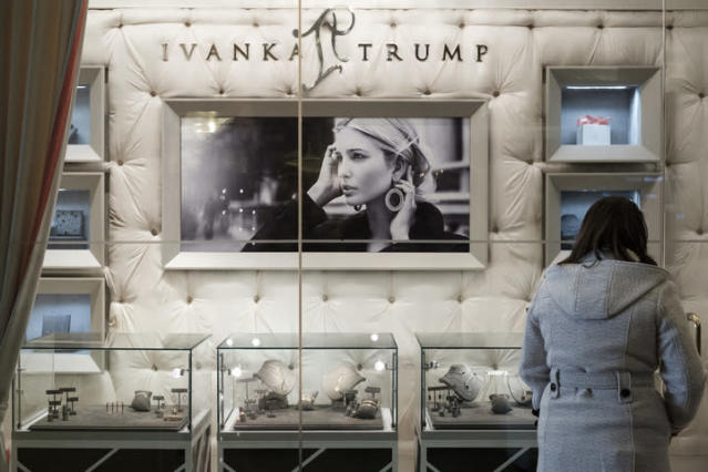 "A woman browses jewelry at the ""Ivanka Trump Collection"" shop in the lobby at Trump Tower in New York City. (Photo: Drew Angerer/Getty Images)"