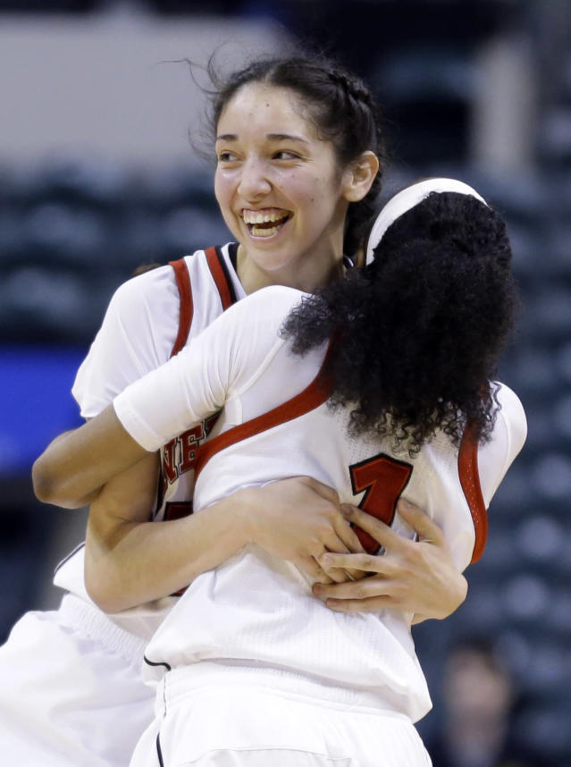 Nebraska forward Jordan Hooper, left, hugs guard Tear'a Laudermill after they defeated Iowa in an NCAA college basketball game in the finals of the Big Ten women's tournament in Indianapolis, Sunday, March 9, 2014. Nebraska won 72-65. (AP Photo/Michael Conroy)