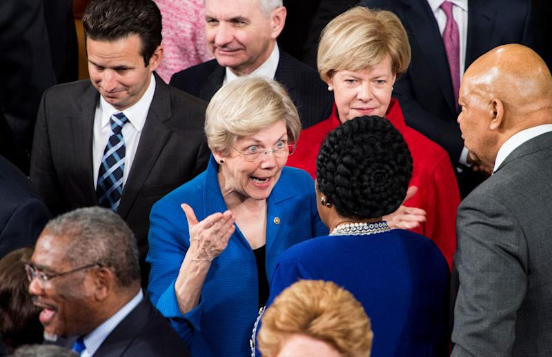 Sen. Elizabeth Warren (D-Mass.) speaks with Rep. Sheila Jackson Lee (D-Texas) as senators arrive for President Barack Obama's State of the Union address in the Capitol on Jan. 20, 2015.