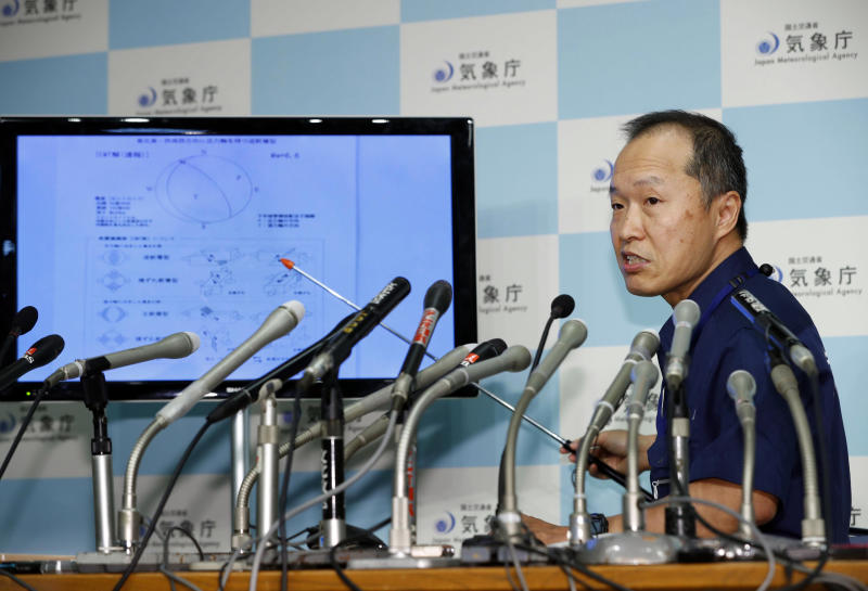 A section chief speaks at a press conference following a strong earthquake in northern Japan, at Japan Meteorological Agency in Tokyo Thursday, Sept. 6, 2018. A powerful earthquake struck the island of Hokkaido. (Kyodo News via AP)