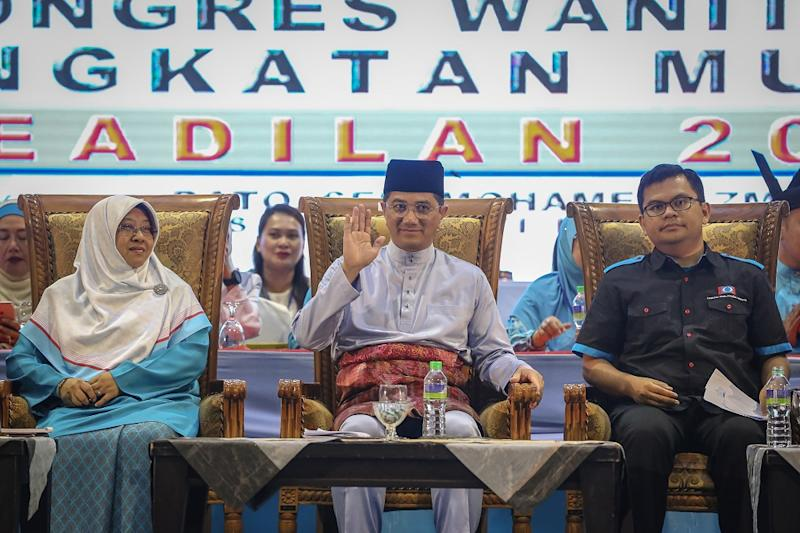 PKR deputy president Datuk Seri Azmin Ali (centre) with PKR Youth chief Akmal Nasrullah (right) and Wanita PKR chief Haniza Mohamed Talha at the opening of the 2019 Woman and Youth National Congress in Melaka December 5, 2019. — Picture by Yusof Mat Isa