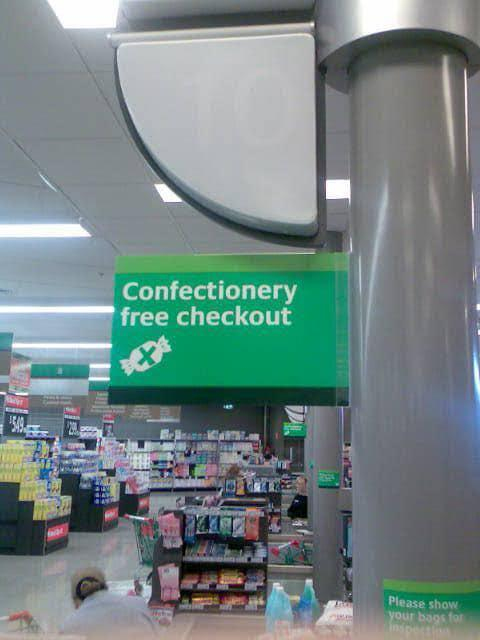 A Woolworths 'confectionery free checkout' sign is pictured. Source: Facebook