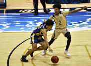 Carver College forward Glenn Sims drives past Golden Panther forward Bernie Andre during the first half of an NCAA college basketball game against Florida International Monday, Dec. 21, 2020, in Miami. (AP Photo/Gaston De Cardenas)
