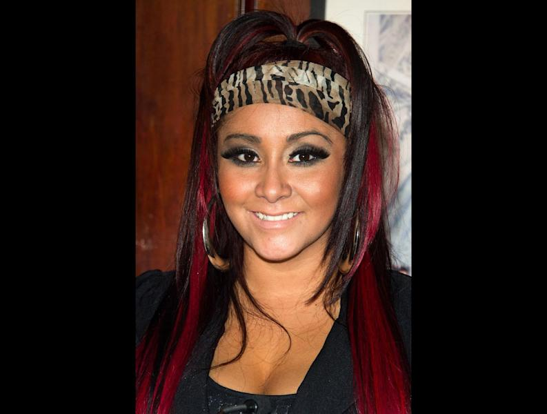 """FILE - Nicole """"Snooki"""" Polizzi attends a press event to announce her new venture, Team Snooki Boxing and the upcoming boxing matches featuring Ireland's Hyland brothers, in New York, in this Jan. 12, 2012 file photo. Snooki gave birth to her first child early Sunday morning Aug. 26, 2012 at Saint Barnabas Medical Center in Livingston N.J. according to MTV. A baby boy weighing 6lbs, 5oz. (AP Photo/Charles Sykes, File)"""