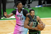 Miami Heat's Bam Adebayo, left, vies for control of the ball with Boston Celtics' Tristan Thompson, right, in the first half of a basketball game, Sunday, May 9, 2021, in Boston. (AP Photo/Steven Senne)