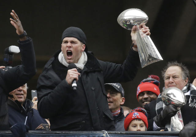 Quarterback Tom Brady holds one of the six Lombardi Trophies he helped the Patriots win. (AP Photo/Elise Amendola)