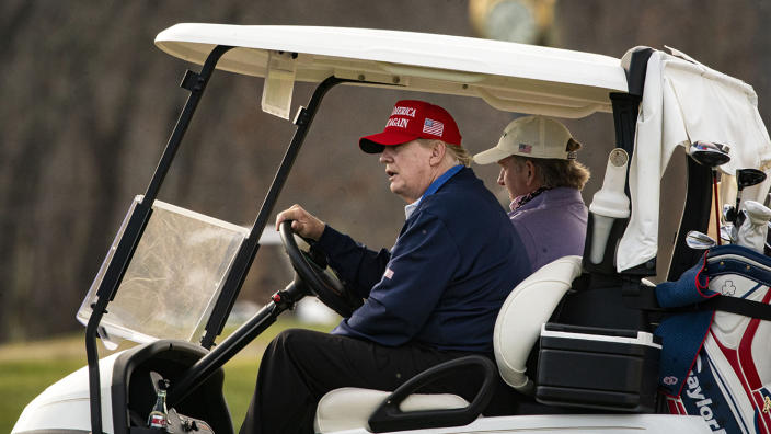 President Trump drives a golf cart at his club in Sterling, Va., Sunday. (Photo by Al Drago/Getty Images)