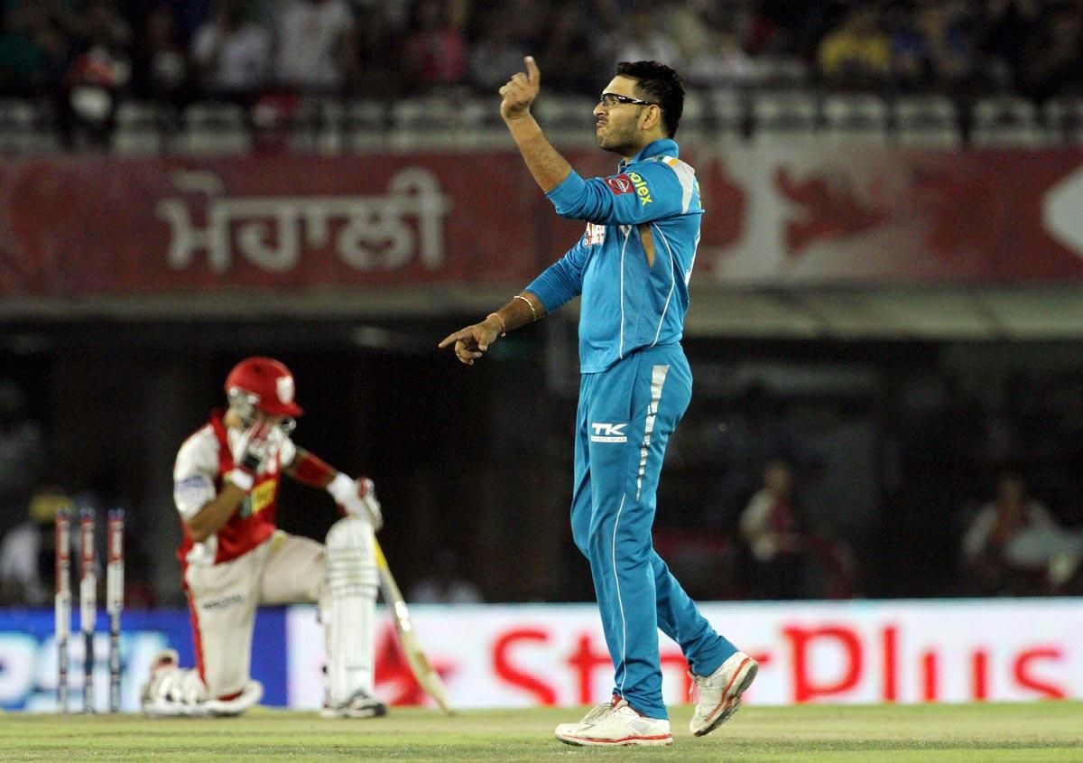 Pune Warriors player Yuvraj Singh celebrates as he takes a wicket during match 29 of the Pepsi Indian Premier League between The Kings XI Punjab and the Pune Warriors held at the PCA Stadium, Mohali, India  on the 21st April 2013. (BCCI)