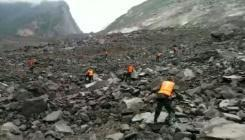 Hopes dim in search for 118 buried by China landslide