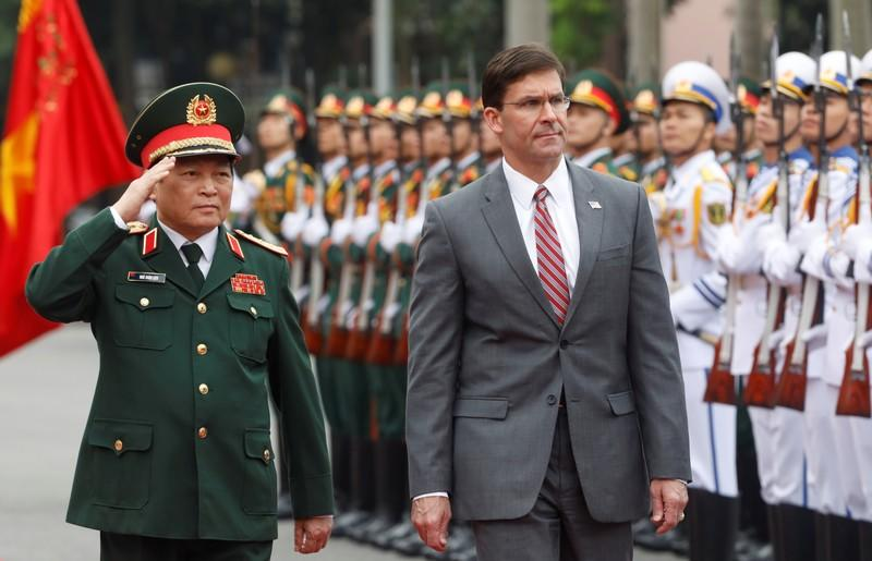 U.S. Defense Secretary Mark Esper reviews the guard of honour with Vietnam's Defence Minister General Ngo Xuan Lich in Hanoi