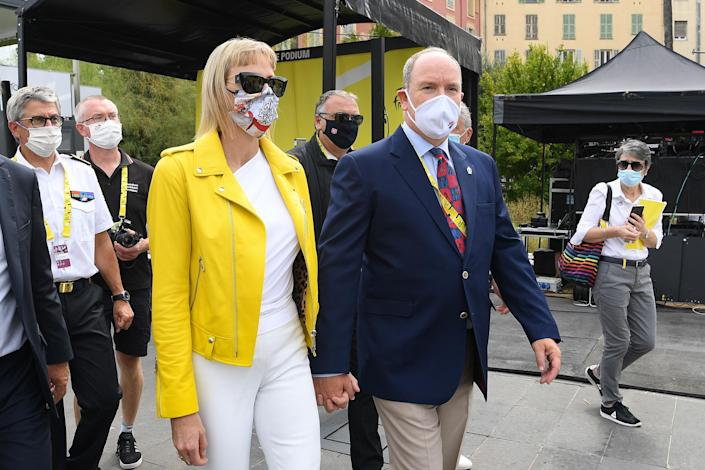 """<p>Opting for the traditional winner's yellow, Charlene surprised cycling fans at the opening of last year's Tour de France. Her yellow leather jacket by Philipp Plein paired perfectly with her <a href=""""https://people.com/royals/princess-charlene-monaco-wears-joker-mask-why-so-serious/"""" rel=""""nofollow noopener"""" target=""""_blank"""" data-ylk=""""slk:unexpected Joker-themed mask"""" class=""""link rapid-noclick-resp"""">unexpected Joker-themed mask</a>.</p>"""